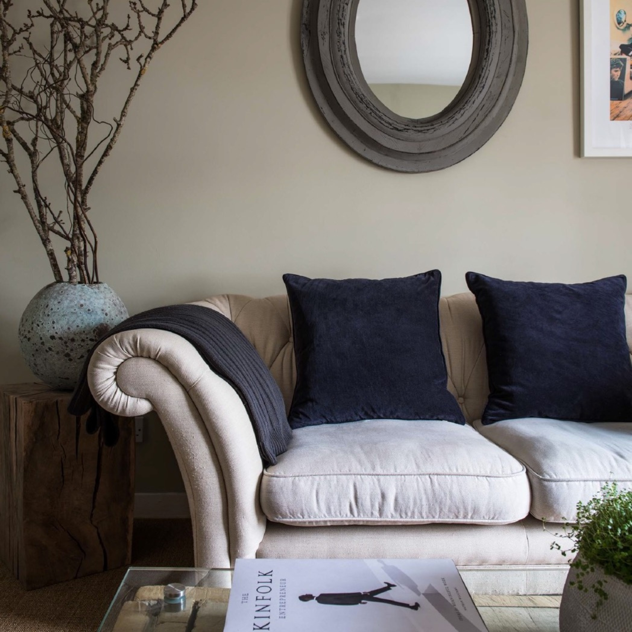 Interior design of lounge living room with sofa, mirror and bespoke table